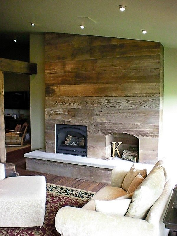 Rustic fireplace made from reclaimed barn wood Hand
