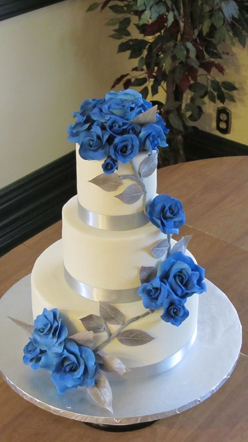 silver wedding cakes  Lemon rasp cake iced with white choc ganache MFF Sapphire blue