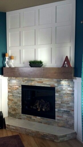 Our Fireplace remodel Desert quartz Ledgestone from Lowes maple boards made into a mantel and