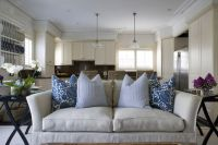 Open concept living room kitchen. Blue white decorative ...