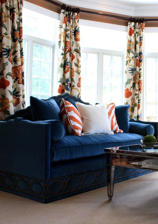 Pretty Bay Window In Living Room Dressed With Bold Orange