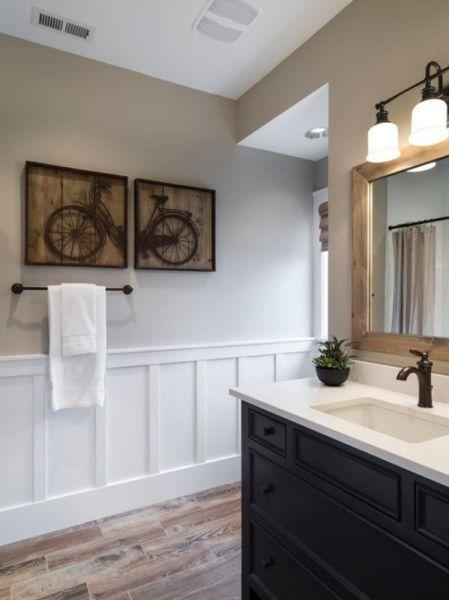 white wainscoting bathroom vanity Beautiful bathroom! Wood tile floors, black vanity, bronze fixtures, and the white wainscoting