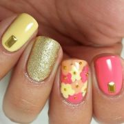 peach coral & yellow floral nails