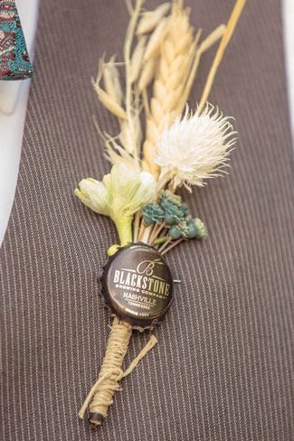 DIY Vintage Boutonnieres created from vintage-inspired bottle caps, a colorful mix of masculine flowers and twine