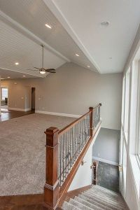 Open concept staircase to basement with wall of windows ...