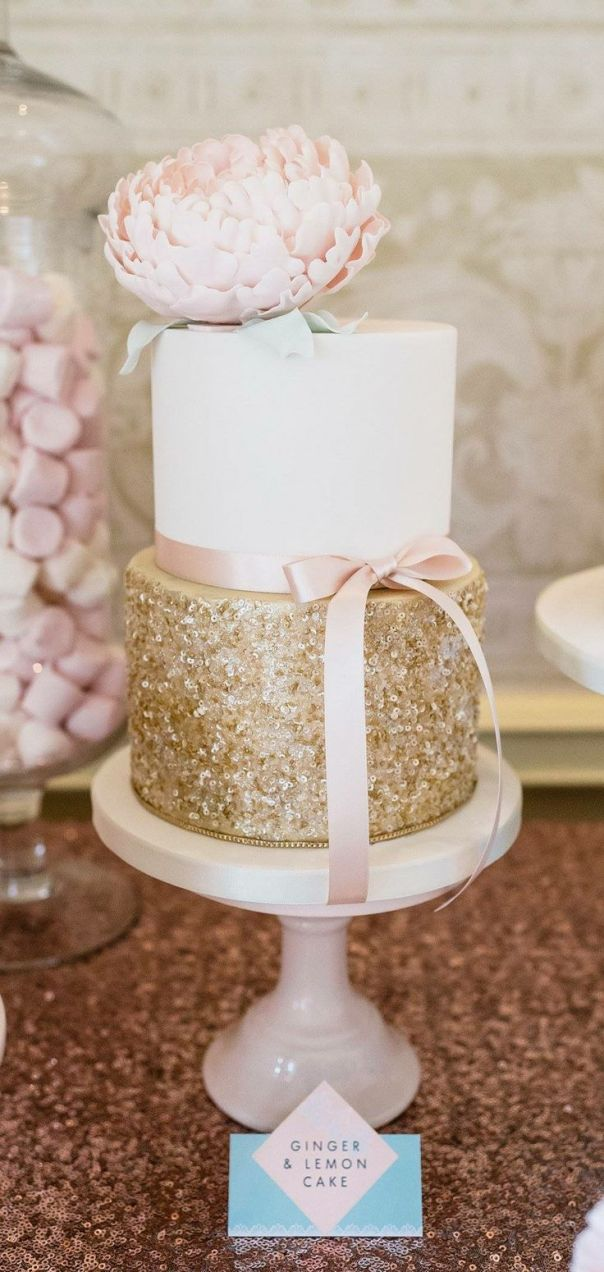 Glamorous two-tiered white and gold wedding cake