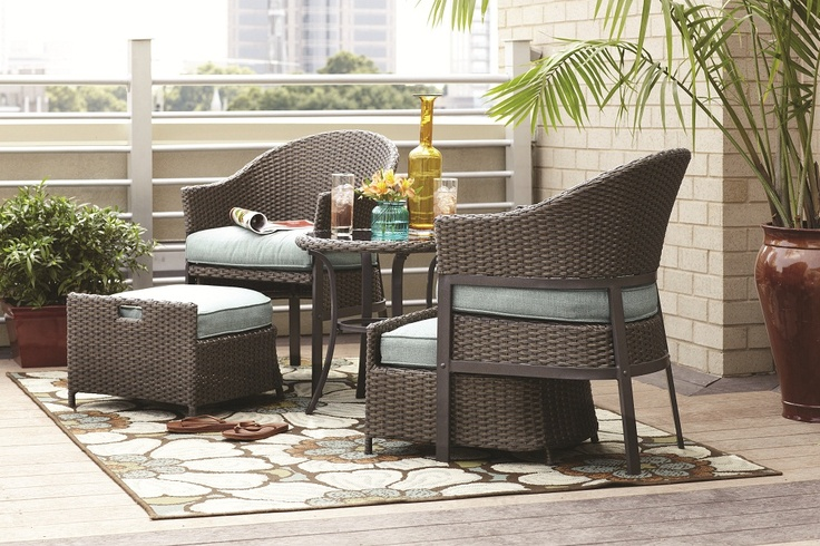 A 5Piece patio conversation set made of wicker with
