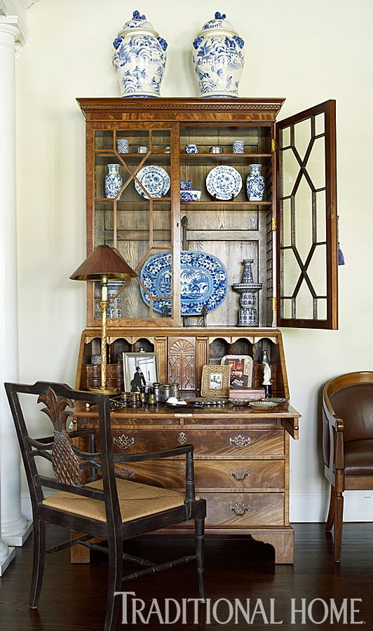 An antique 1920s secretary multitasks as a display case