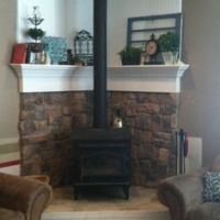 decorating a small living room with a corner woodstove ...