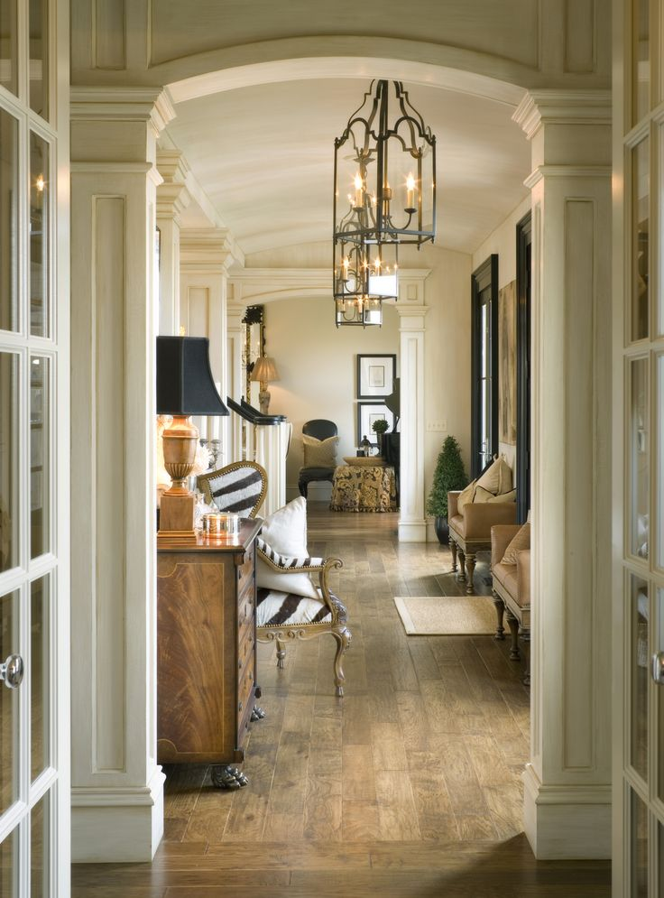 Beautiful hallway with gorgeous moldings framing the