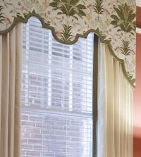 Custom scalloped cornice board with drapery panels.