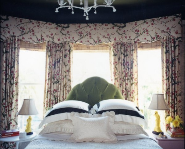 bed in window, green velvet headboard