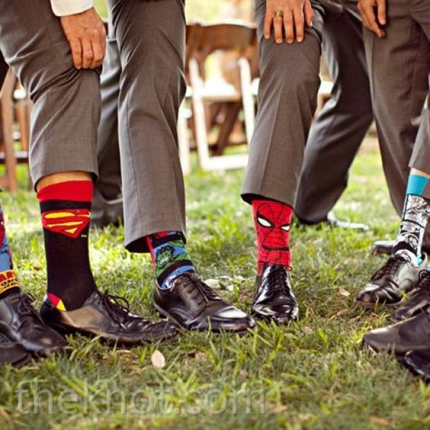 The guys jazzed up their gray suits with superhero socks--a gift from the groom.: