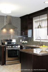 Delicious chocolate-stained maple cabinets topped with ...