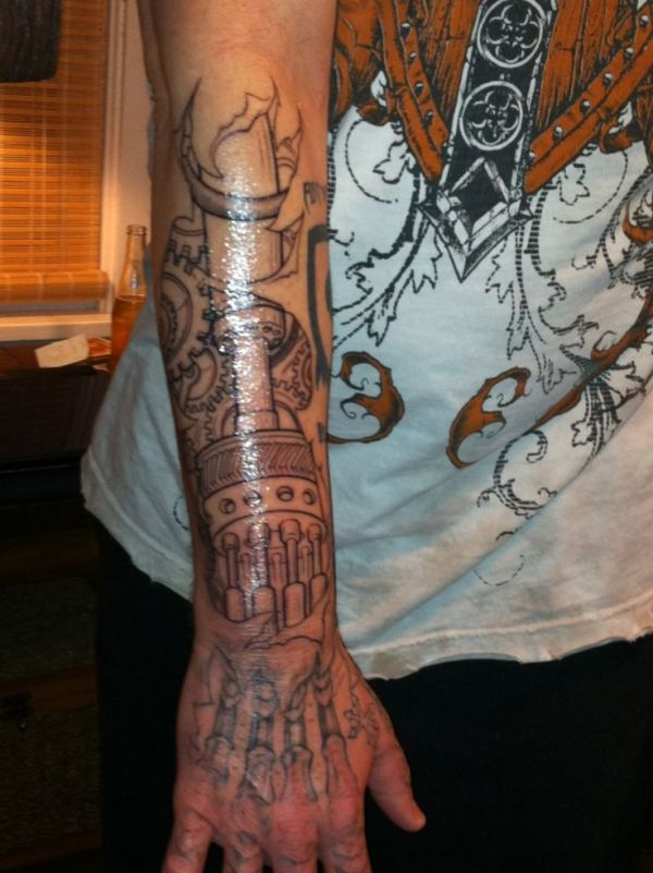 robotic hand and arm tattoos