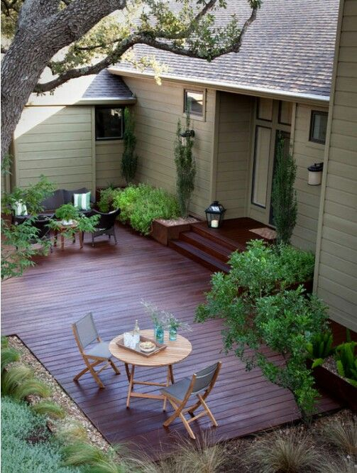 Love the dark wood and ground level deck  Beautiful Deck  Patio Designs  Pinterest  Wood