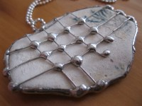 old tile pendant decorated with copper wire and soldered ...