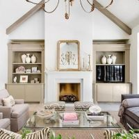 Fireplace with built ins and vaulted ceiling