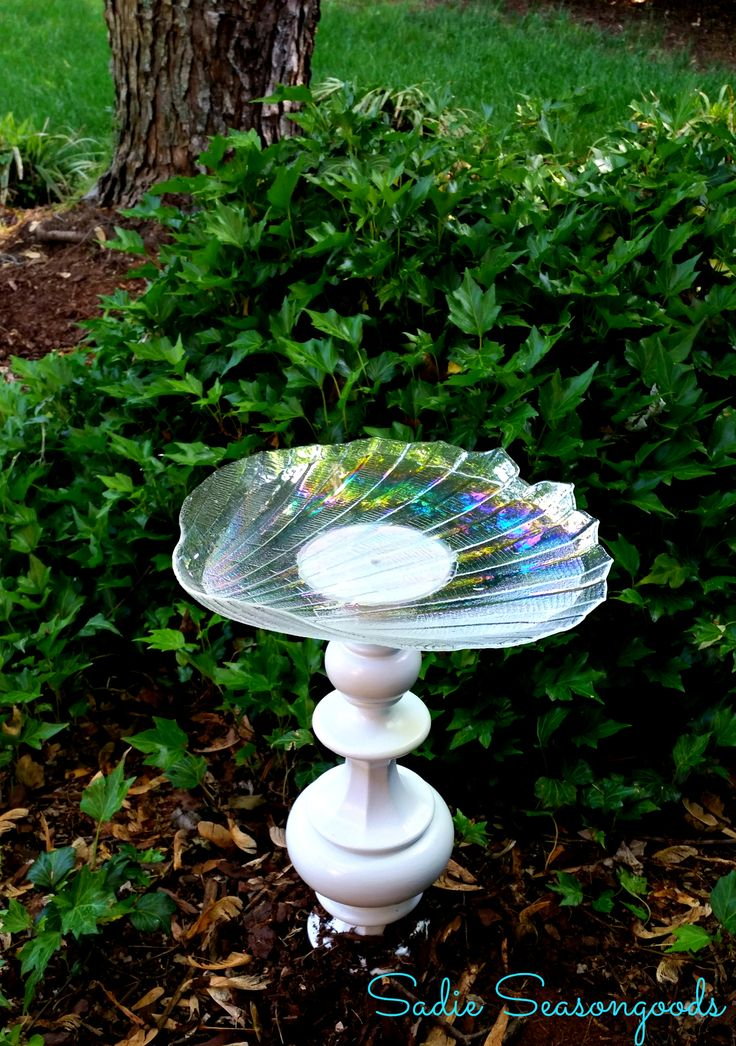 Upcraft a fun bird bath using an old lamp for the base and a glass platter or dish from the