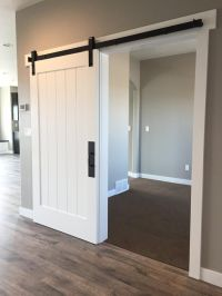 White barn door for the entry closet! http://www