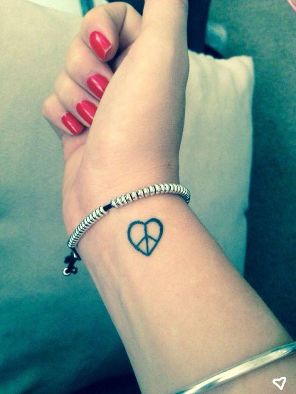 peace heart small wrist tattoo