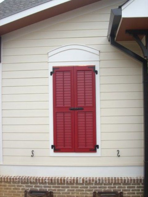 Louvered Shutters with Control Rod  Closed over Opening