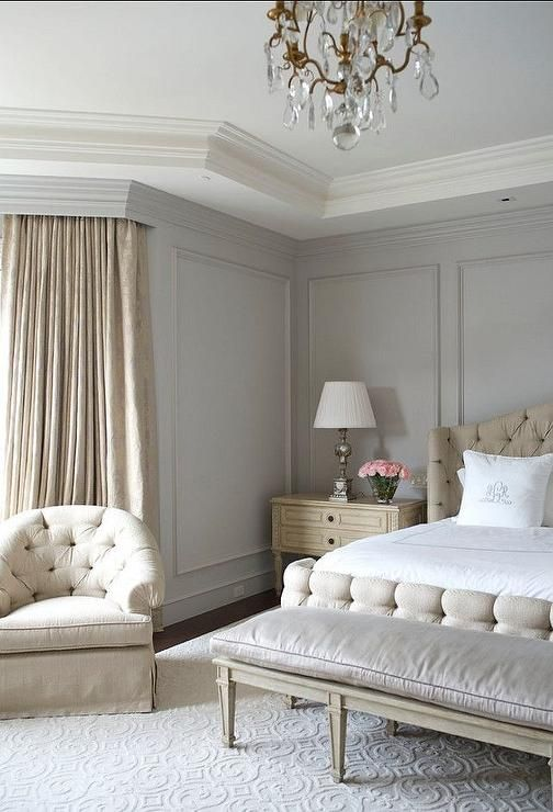 Beige and gray bedroom features gray walls painted Benjamin Moore Wickham Gray accented with