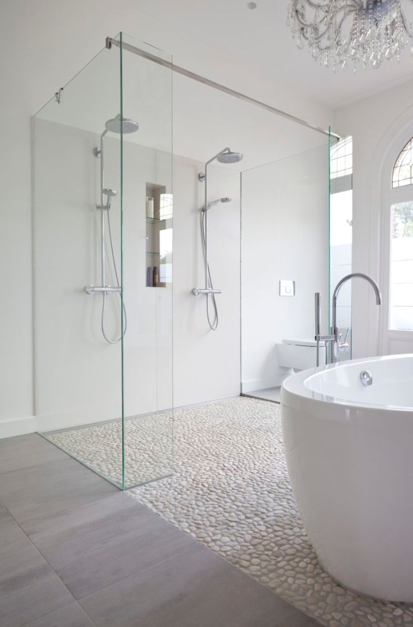 Clean white bathroom using white pebble tile floor in shower and as flooring. https://www.pebbletileshop.com/products/White-Pebble-Tile.html#.VaV6pPlViko: