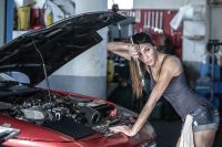 Sexy Garage girl repair Ford Car by Fabrice Meuwissen on