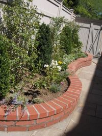 Brick Wall Garden | Backyard Flower Bed Buildouts ...