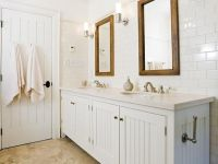 Crisp white cottage beachy bathroom design with white ...
