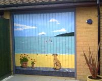 Painted garage door with a coastal beach scene and dog ...