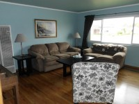 living room, blue walls and brown couch and loveseat
