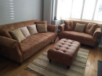 Tan leather sofa grey walls natural rug living room white ...