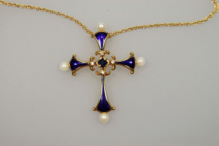 The Well Known Midnight Sapphire Cross From The Franklin