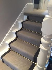 Grey Carpet with Black Border and Golden Stair Rods to