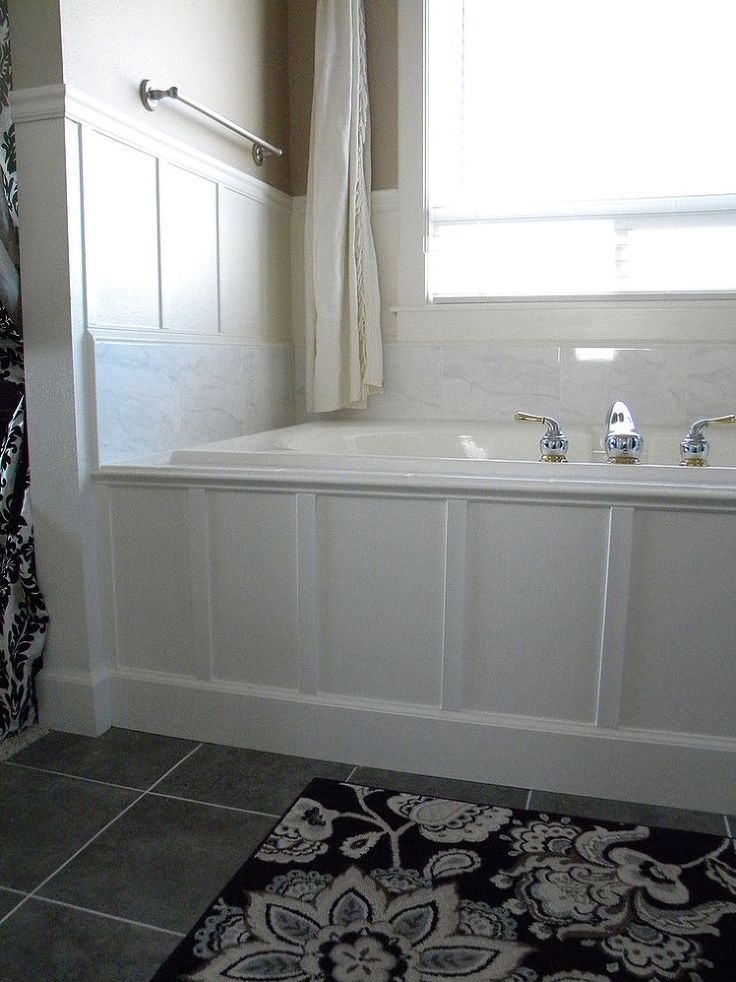 updated 90s bathtub in one weekend with less than $200, using marble and paneling over the existing old
