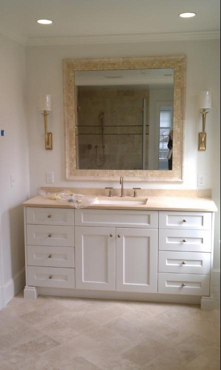 Limestone white cabinets visual comfort light kohler