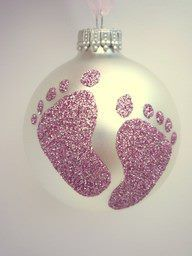 Dip babys foot in glue and then press foot onto the ornament. Then glitter the ornament. First Christmas.
