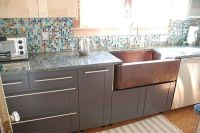 love the copper sink with the dark grey cabinets...and the ...