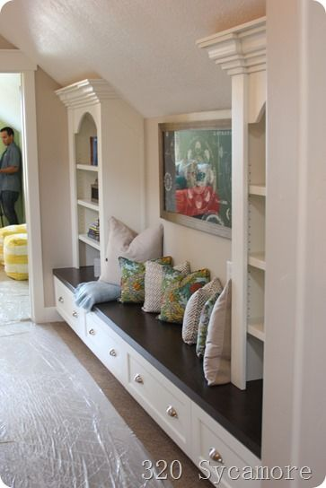 Clever Use Of Space In Hallway And Under Sloped Ceilings