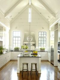 A vaulted ceiling and bead board reinforce the country ...