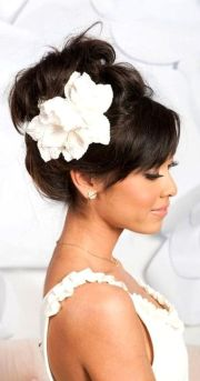 high looped updo with bangs & flower