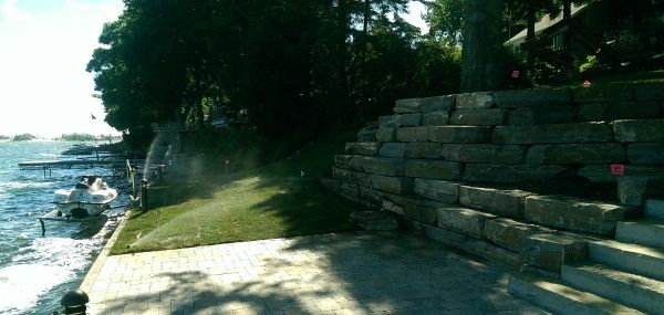 A large block stone retaining wall is used to deal with a