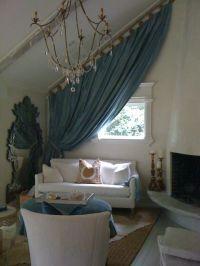 Slanted ceiling? Slanted drapes :] Cottage living room by ...