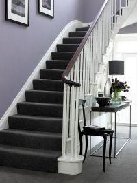 Purple walls, white trim, dark brown/black furniture and ...