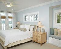 Light blue, beige, white bedroom with light wood furniture ...