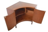 English modern mid century corner cabinet in teak.