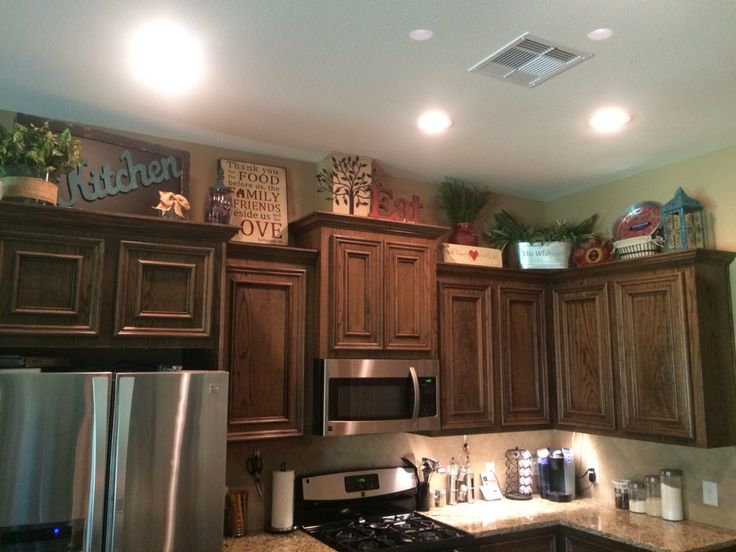 Above kitchen cabinets decor  Awesome  Pinterest  Above kitchen cabinets Decor and Cabinet