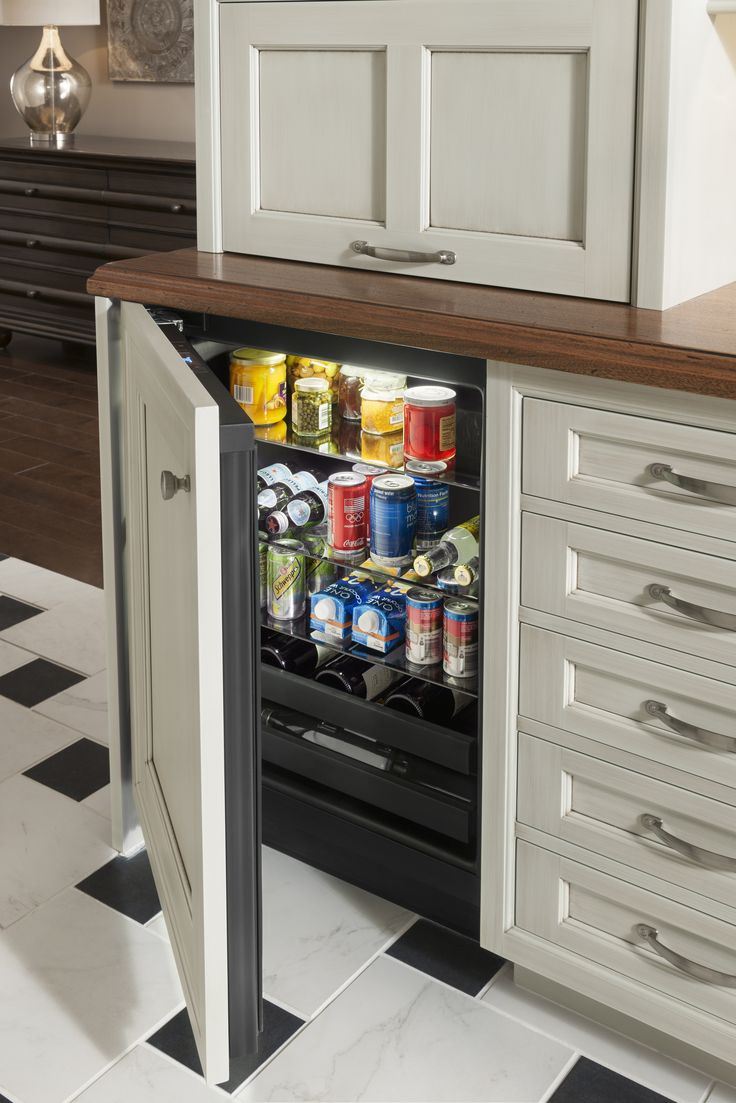 Wet bar refrigerator panel by WoodMode shown in Vintage
